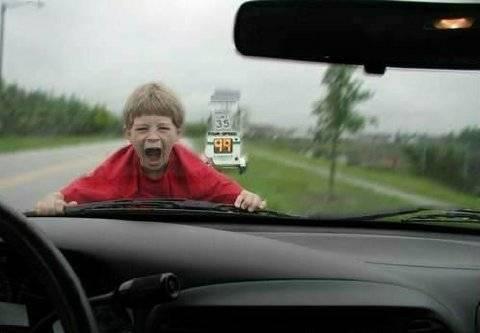 Crying kid on windscreen